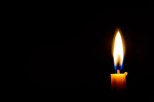 Depositphotos_59720475-Stock-Photo-Candle-Light-In-The-Dark